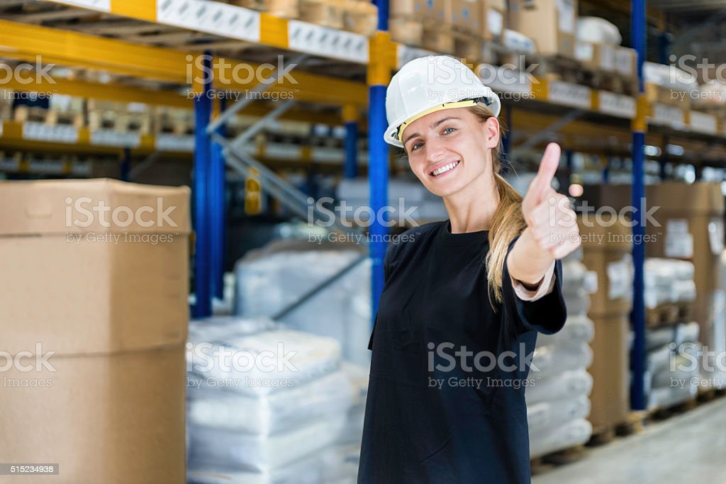 Warehouse worker showing thumb up stock photo