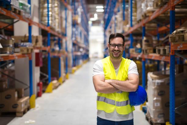 warehouse worker. smiling worker in distribution center. - soddisfazione foto e immagini stock