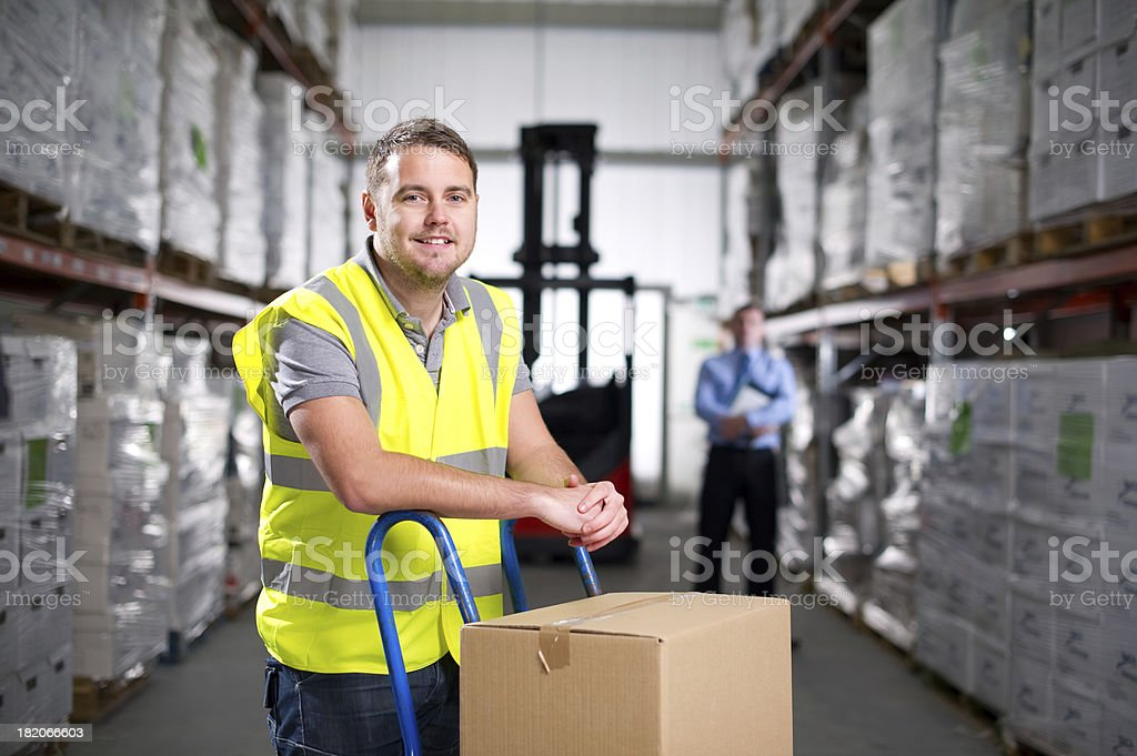 Warehouse Worker Using a Hand Truck stock photo