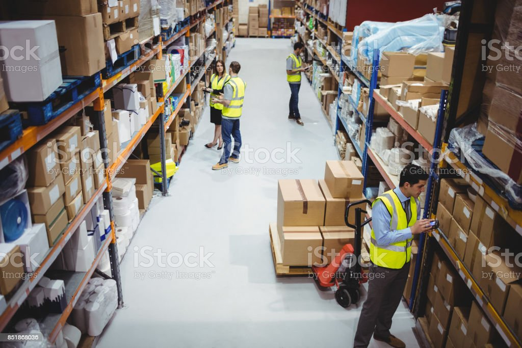 Warehouse worker using hand scanner stock photo