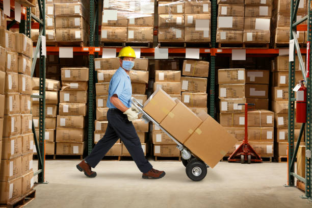 Warehouse Worker Wearing Protective Mask stock photo