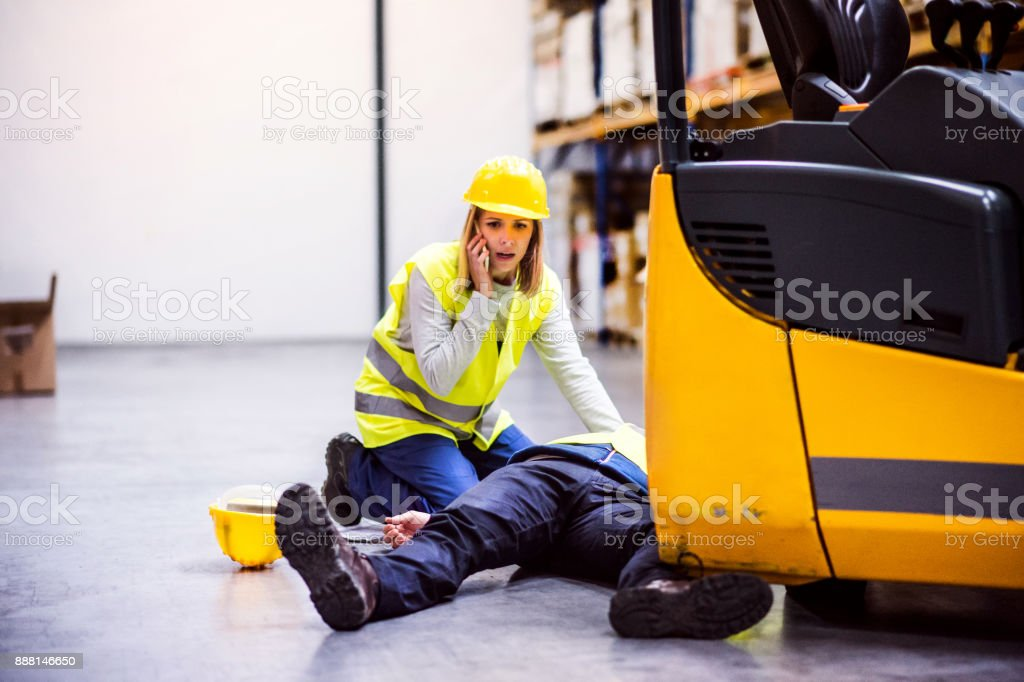 Warehouse workers after an accident in a warehouse. – zdjęcie