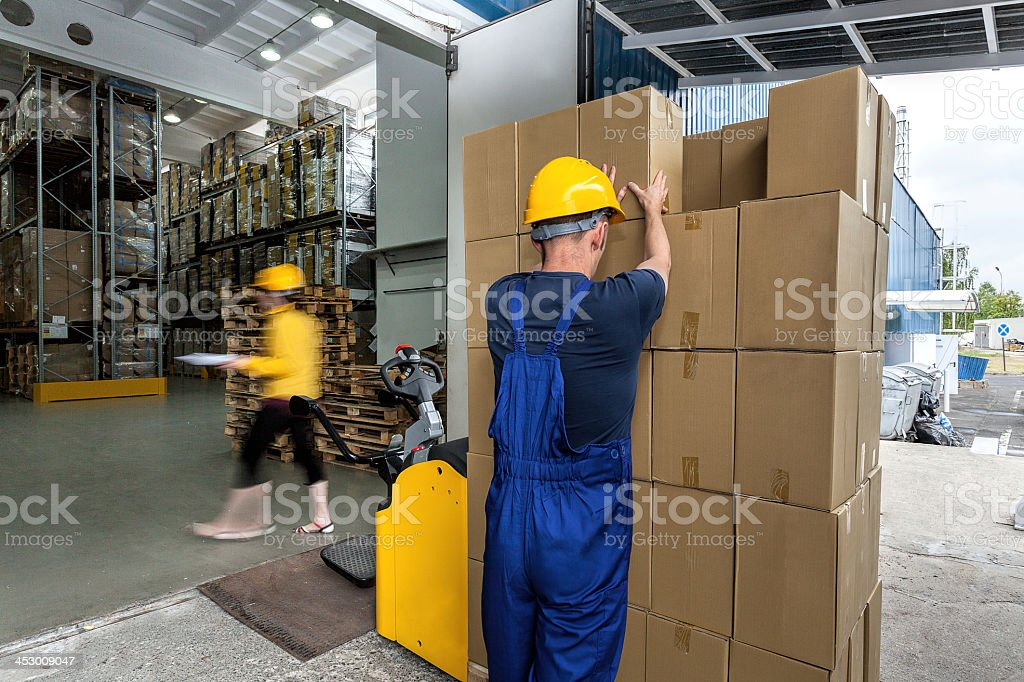 Warehouse workers doing their work stock photo