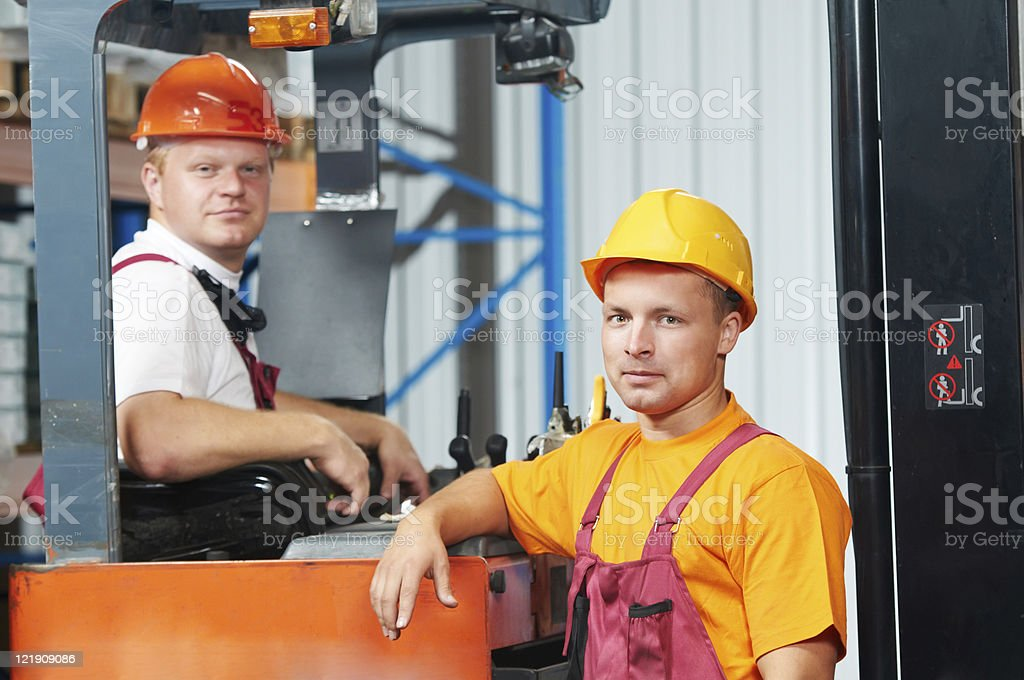 warehouse workers in storehouse royalty-free stock photo