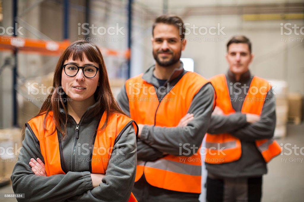 Warehouse workers portrait in work overalls stock photo