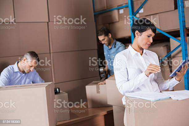 Warehouse Workers Preparing A Shipment Stock Photo - Download Image Now