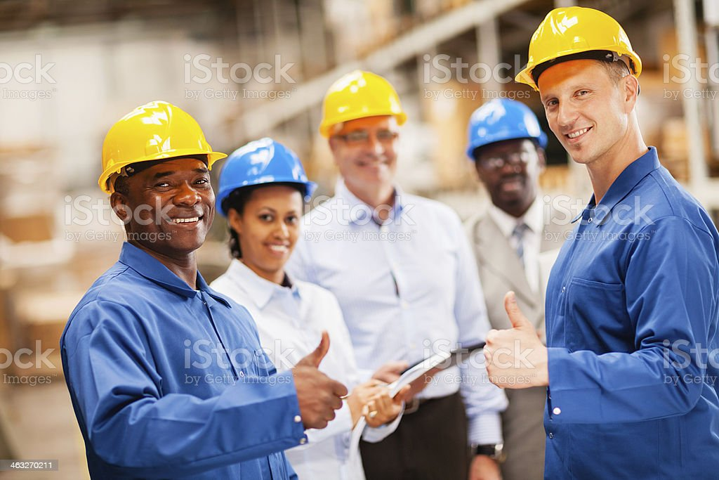 Warehouse workers showing thumb up royalty-free stock photo