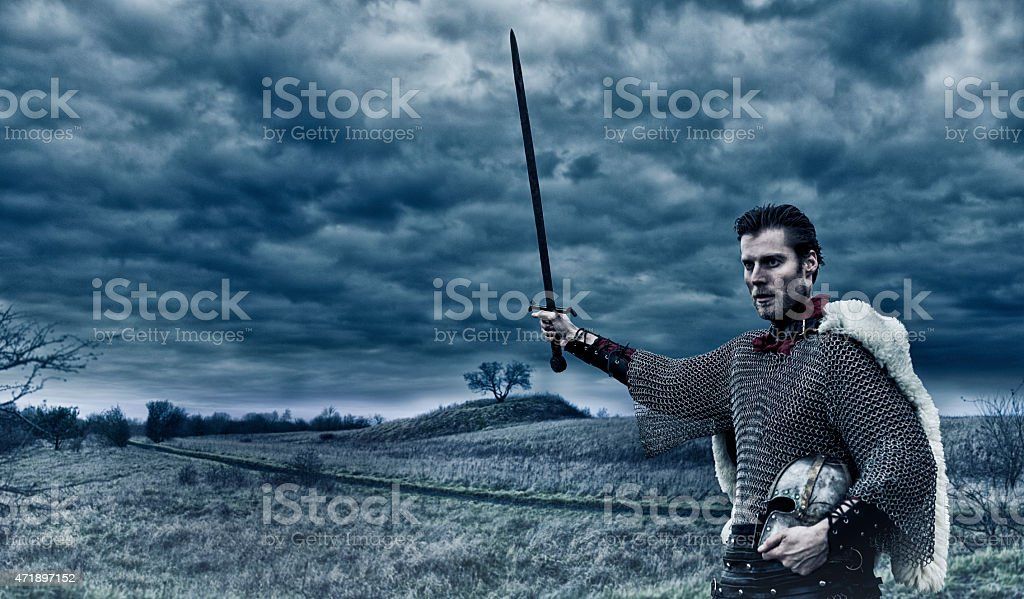 Warlord with sword and helmet is ready for battle stock photo