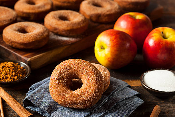 Warm Apple Cider Donuts Warm Apple Cider Donuts Ready to Eat hot apple cider stock pictures, royalty-free photos & images