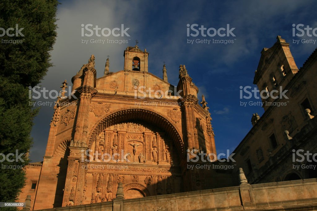 A warm beautiful sunset in Salamanca, Spain. The sun's rays will reflect on the old buildings. Blue sky and clouds. stock photo
