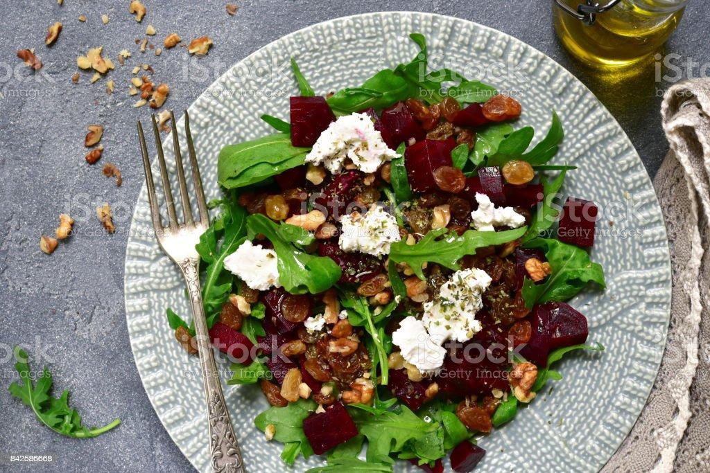 Warm beetroot salad with arugula,raisins and feta stock photo