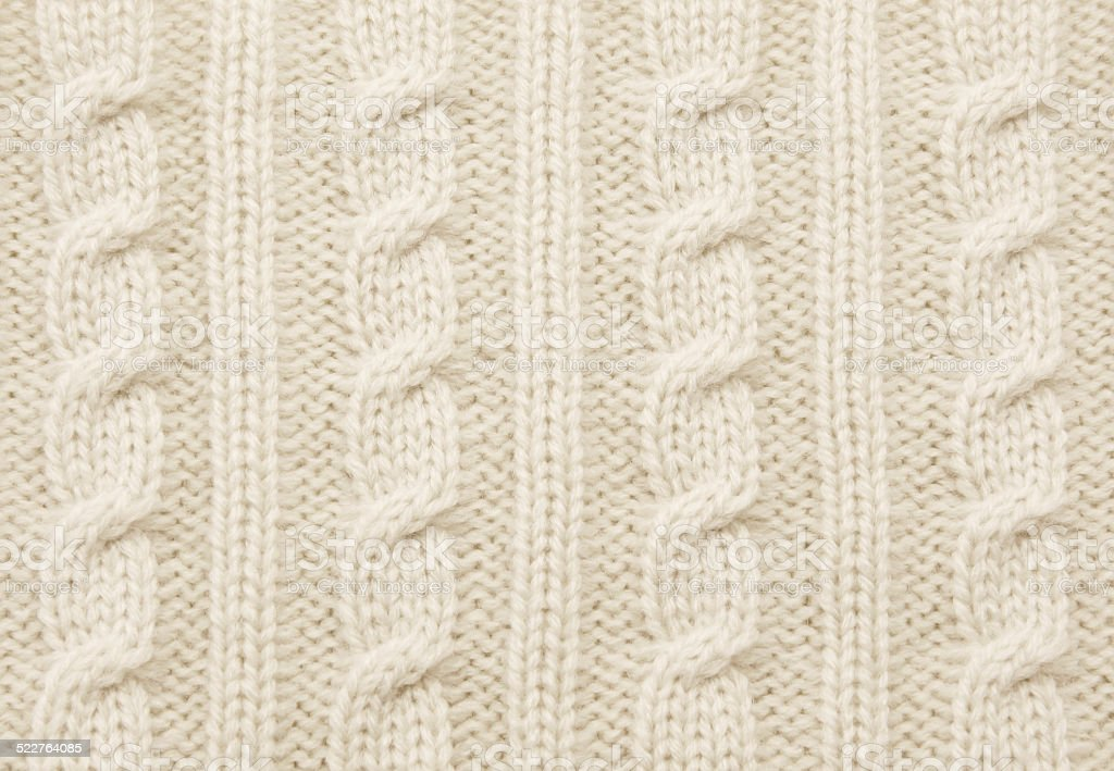 Warm beige cable knit close-up stock photo