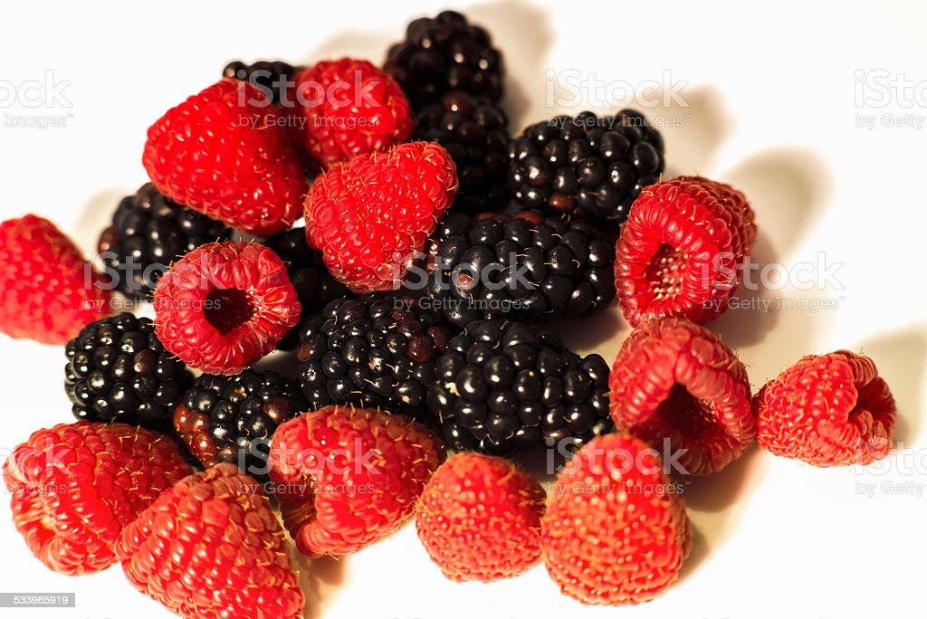 Warm blackberries and raspberries. stock photo