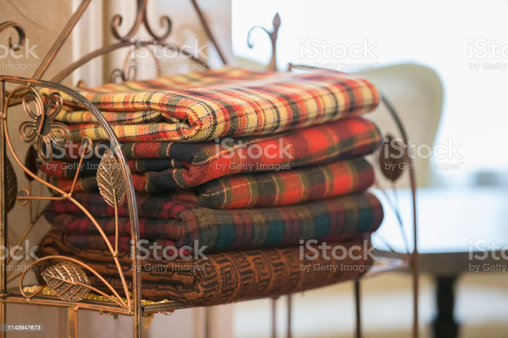 Warm blankets in the cell folded pile. Blankets