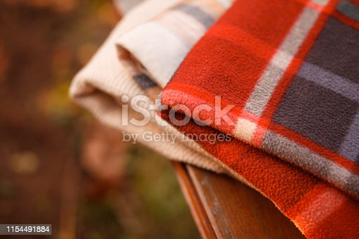 Close-up shot of warm blankets on a bench