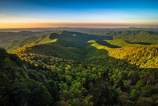 Warm Blue Ridge Mountain Sunrise 3 The colorful sunrise of the ancient Blue Ridge Mountains taken during the spring blooms along the scenic Blue Ridge Parkway in North Carolina appalachian trail stock pictures, royalty-free photos & images