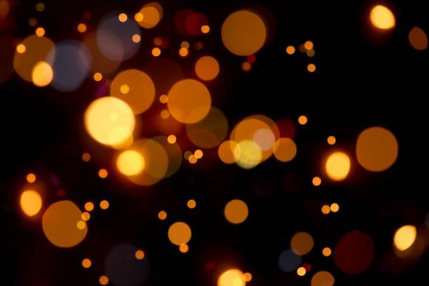 -多重ライトのオレンジ色の温かいボケ - 街灯 ストックフォトと画像