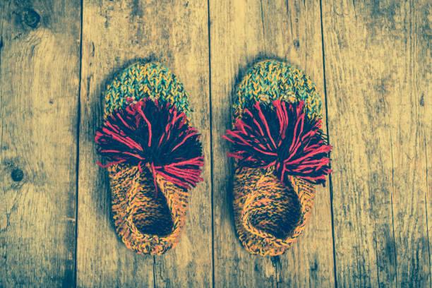 warm clothes for winter, shoes from wool, woolen clothing - babyschuhe nähen stock-fotos und bilder