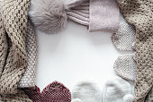 Knitted clothes flat lay background with copy space.