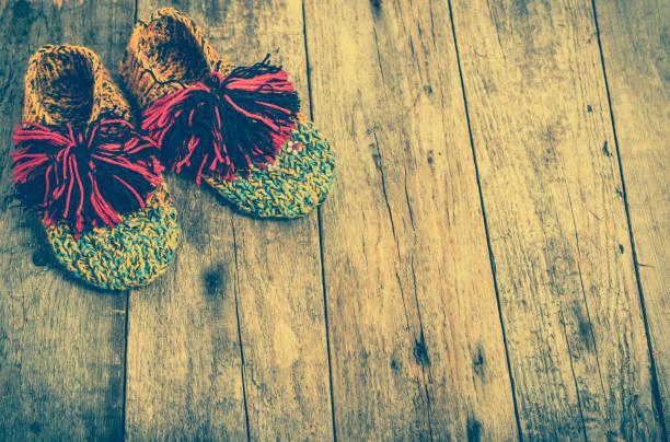 warm clothing for a baby, boots from wool, woolen clothes - babyschuhe nähen stock-fotos und bilder