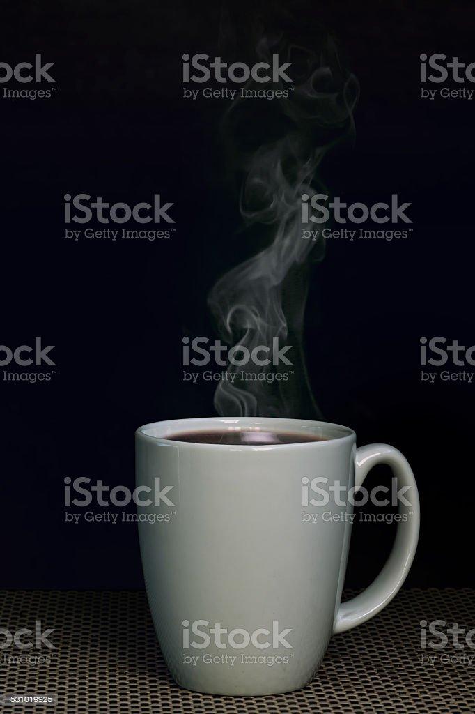 Warm Coffee Warm coffee mug in front of black background 2015 Stock Photo