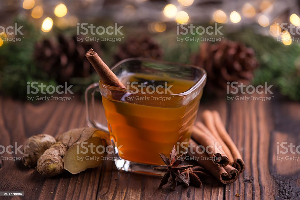 Warm drink for winter: tea, cinnamon, star anise, and ginger stock photo
