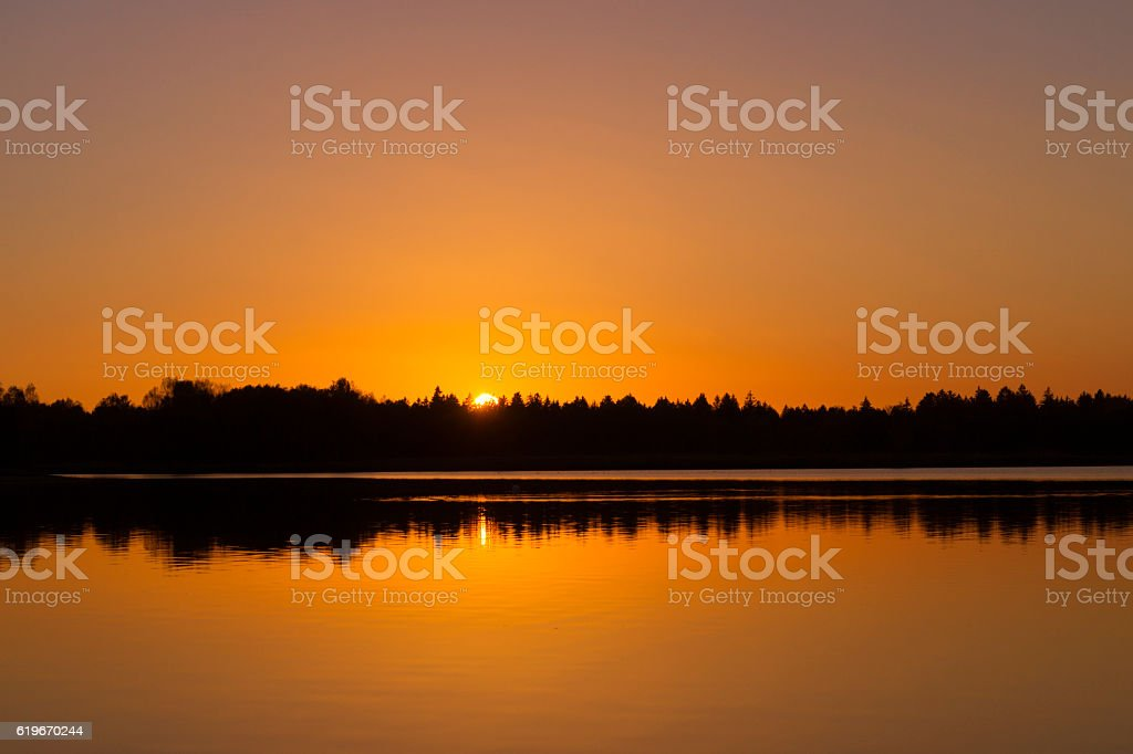 Warm evening light at the lake in the autumn time stock photo