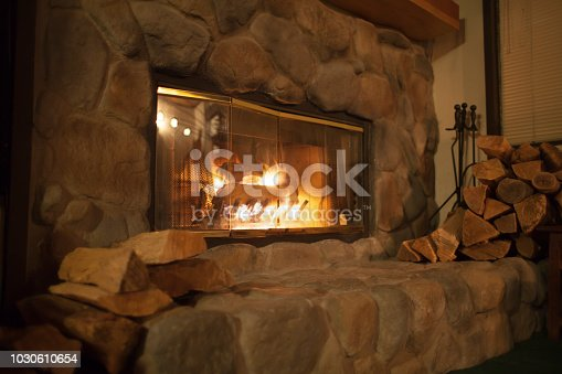 Warm Fireplace with wood on the sides