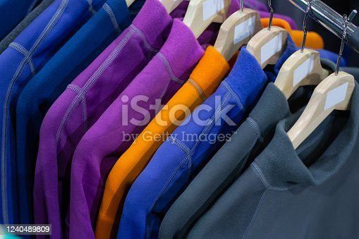 Warm fleece jackets hanging on the  rack in the sport shop