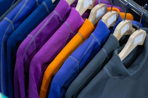 Warm fleece jackets hanging on the  rack in the sport shop