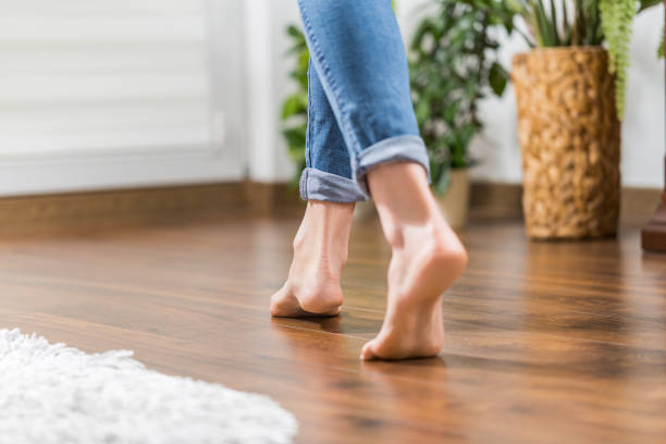 warm floor - the concept of floor heating and wooden panels. - warm house stock photos and pictures