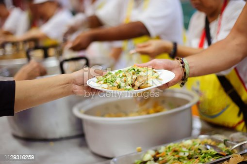 Warm food for the poor and homeless : concept giving with charity