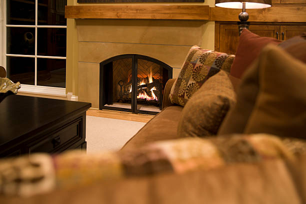 Warm gas fireplace and relaxing living room. stock photo