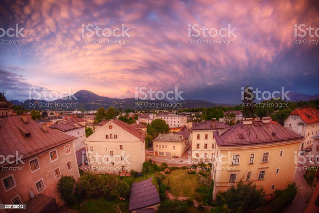 Warm Glow of Sunset and Approaching Storm Over Historic Europe stock photo