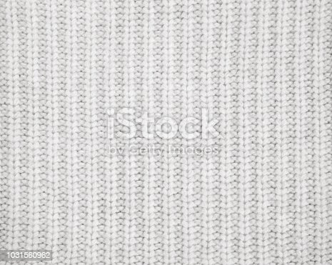 istock Warm gray knitted wool background 1031560962