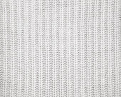 Warm gray knitted wool background