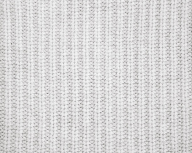 warmes grau gestrickter wolle hintergrund - wollschal stock-fotos und bilder