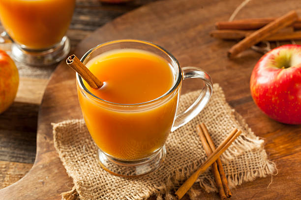 Warm Hot Apple Cider Warm Hot Apple Cider Ready to Drink in Autumn hot apple cider stock pictures, royalty-free photos & images