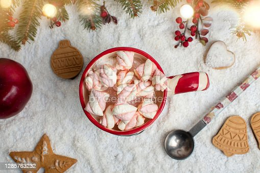Warm marshmallow dessert beverage on a table with festive background for Christmas and New Year winter holiday season
