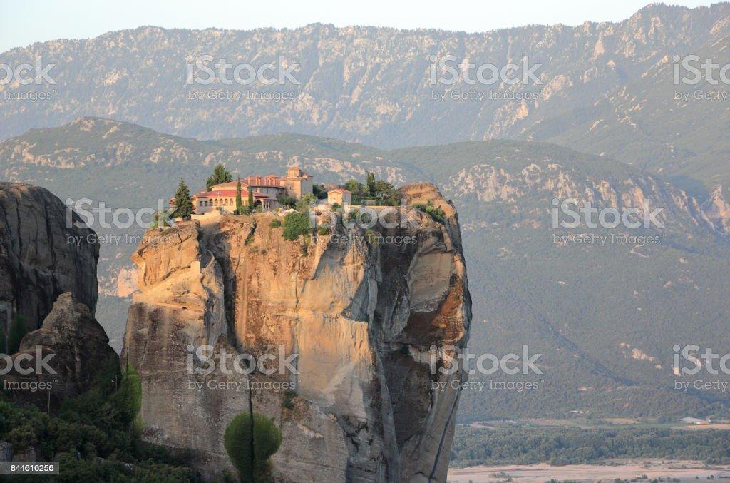 Warm morning light in Meteora. The Monastery at sunrise. Kalambaka, Kastraki, central Greece. stock photo