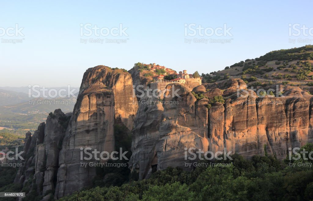 Warm morning light in Meteora. The Monastery of Varlaam and Great Meteoron at sunrise. Central Greece. stock photo