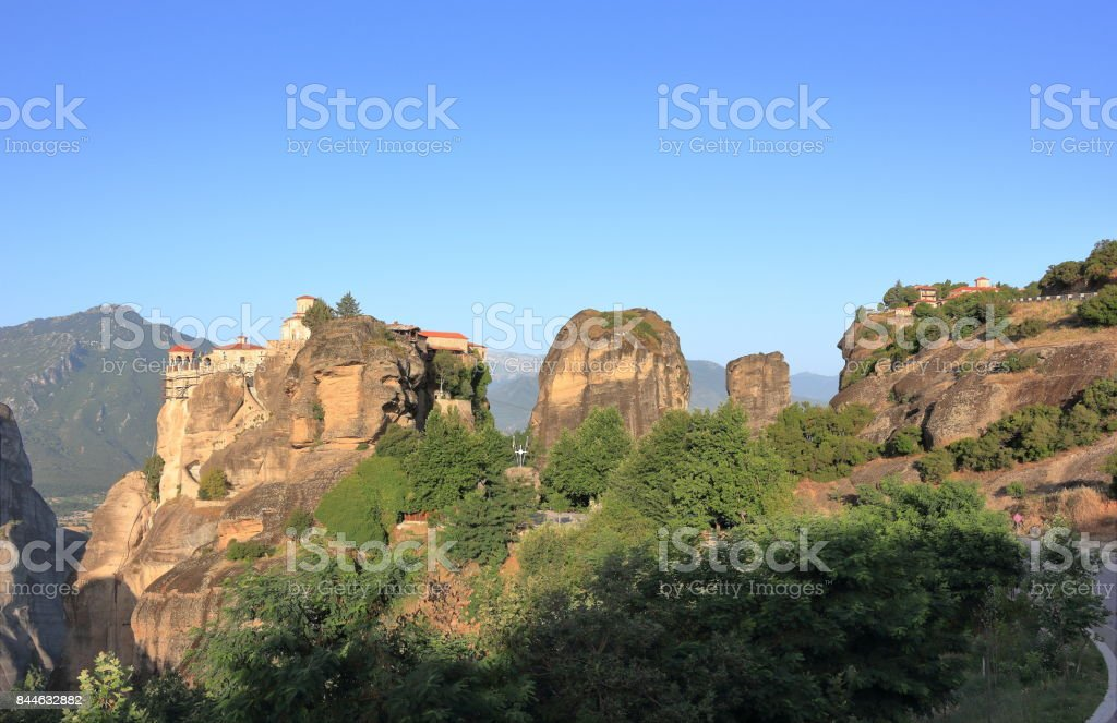 Warm morning light in Meteora. The Monastery of Varlaam at sunrise. Central Greece. stock photo
