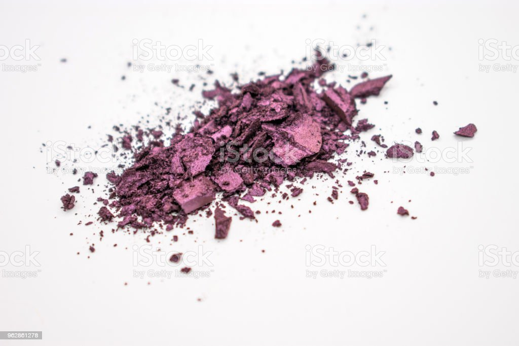 warm purple eyeshadow crumbles stock photo