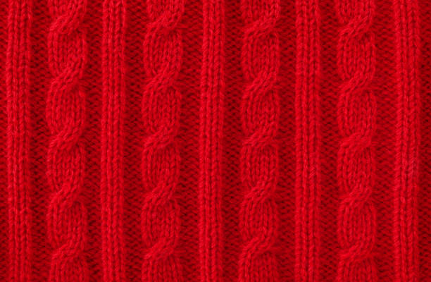 Warm Red Cable Knit Wool Background Cable knit wool close-up sweater stock pictures, royalty-free photos & images