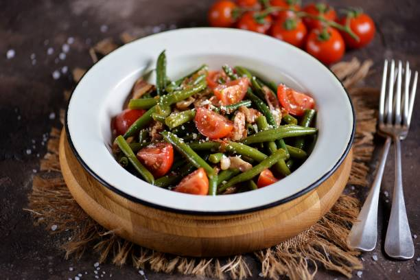 Warm salad of green beans stock photo