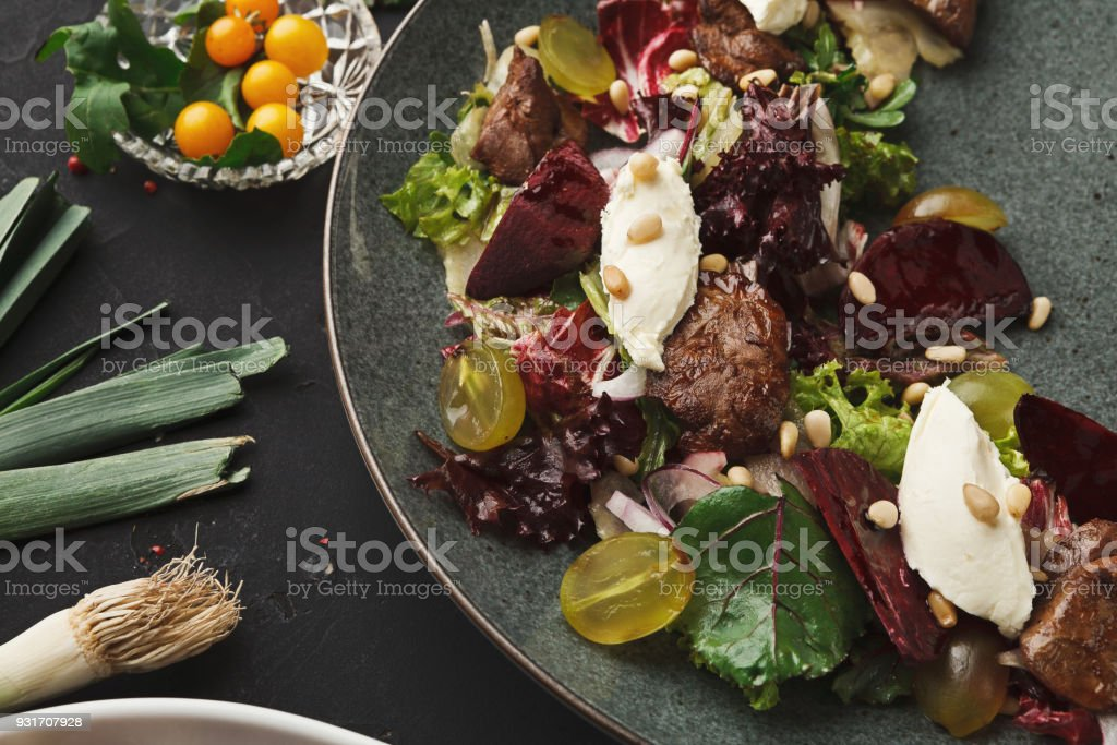 Warm salad with beetroot and cheese served at restaurant stock photo
