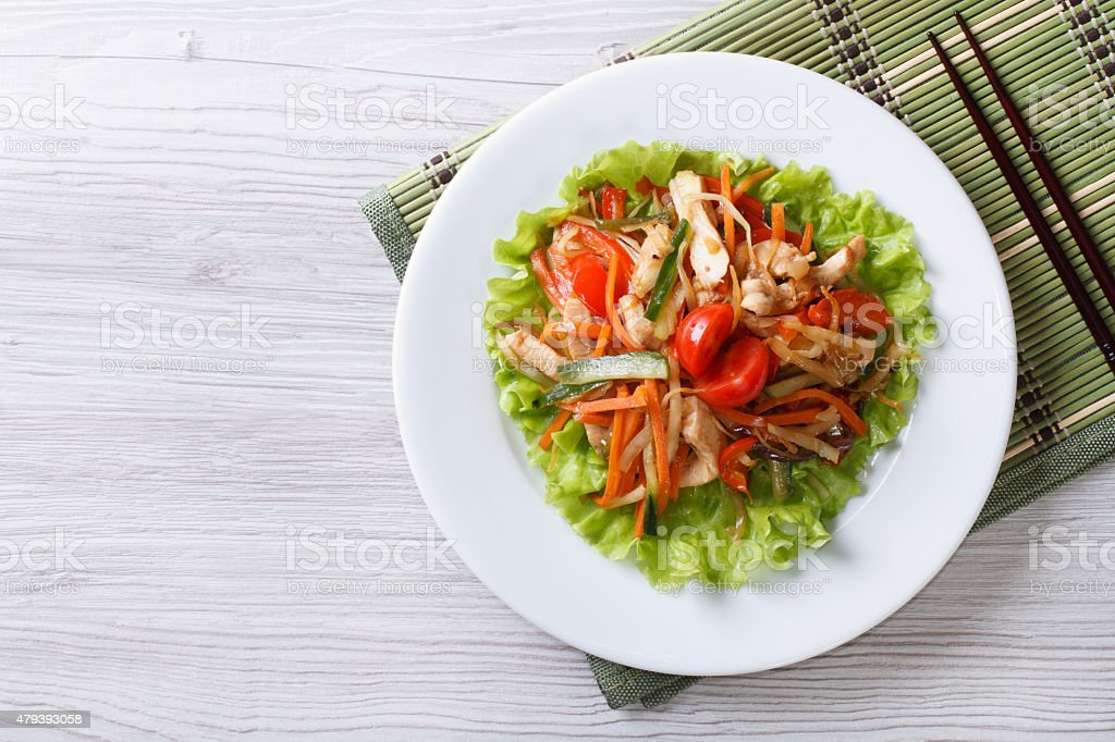 warm salad with chicken and vegetables horizontal top view stock photo