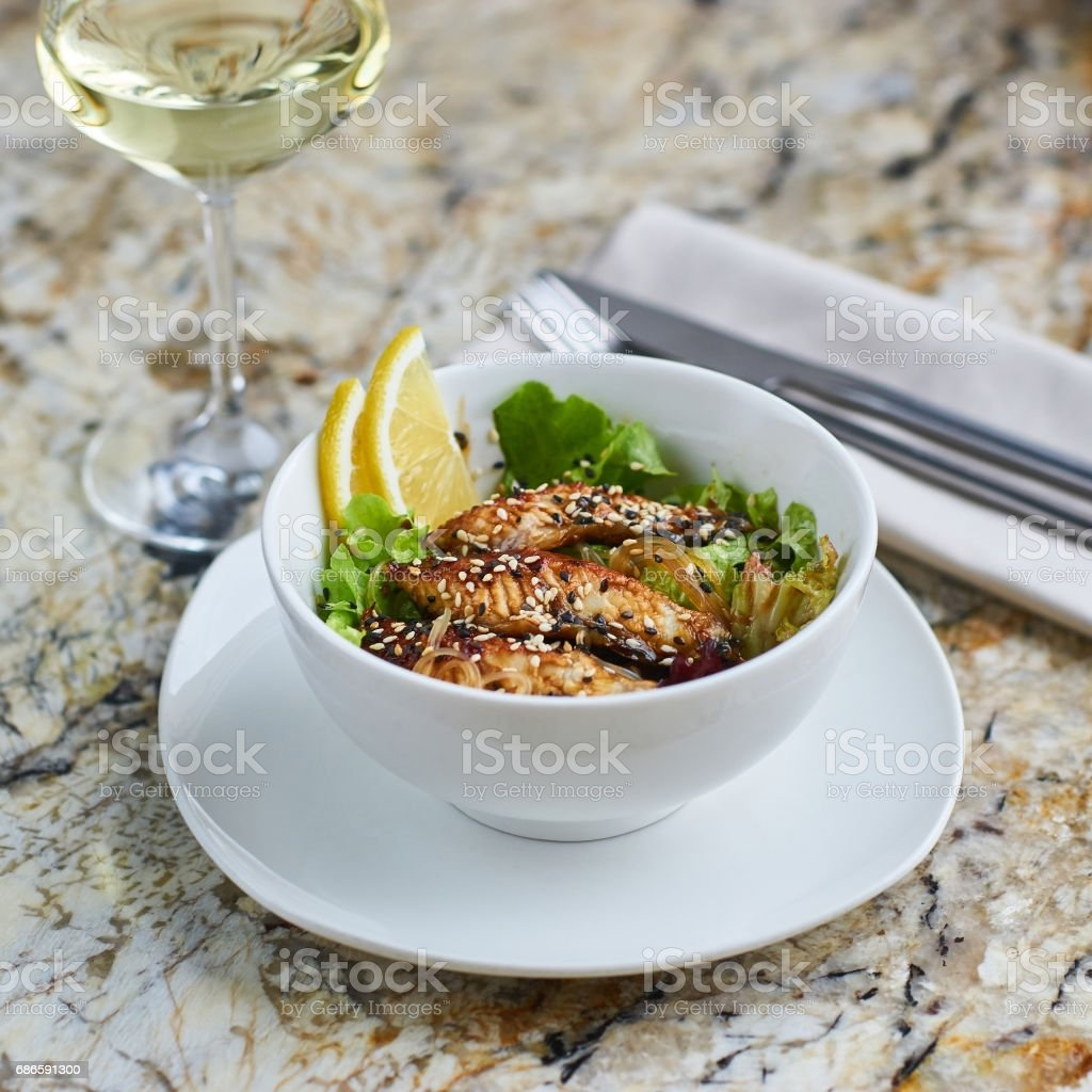 Warm salad with eel and rice photo libre de droits