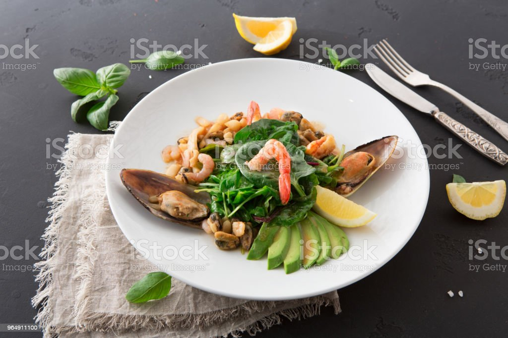 Warm salad with grilled seafood flat lay royalty-free stock photo