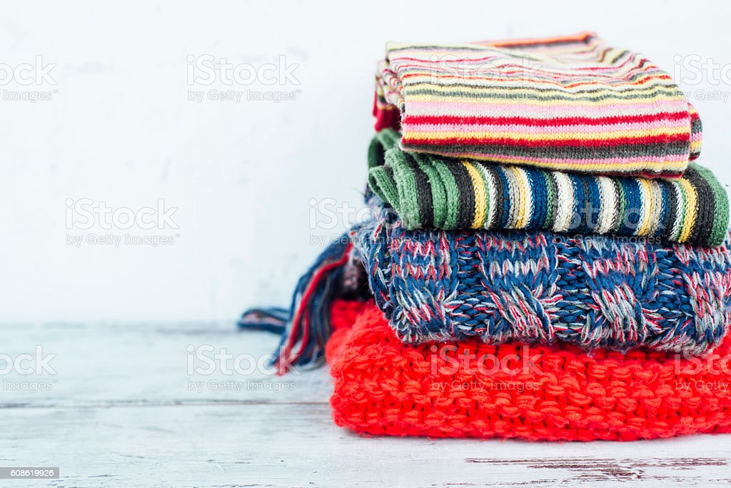 Warm scarves of lying in stack on wooden table stock photo